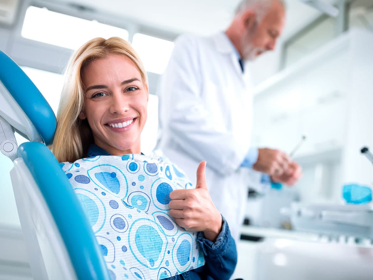 Happy Woman After A Tooth Extraction Procedure In Clearwater